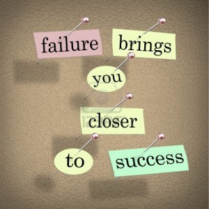 14507871-the-words-failure-brings-you-closer-to-success-on-pieces-of-paper-pinned-to-a-bulletin-board-encoura